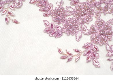 Texture, background, pattern.  Luxury 3D Beaded lace fabric, hand made Pink pearl beads 3D flowers, pink French Embroidered lace, Beads Wedding Lace