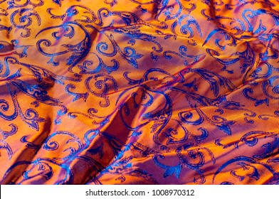 Texture. Background. Pattern. Silk fabric is a dark brown color. royal coloring, decorative pattern, lining fabric under the garment