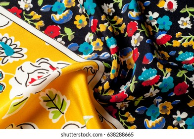 Texture background pattern. Silk fabric, floral pattern on a yellow background. On a black background. Flower textile or fabric. Texture of fabric. textiles, fabric, material, woven.