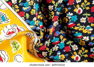 Texture background pattern. Silk fabric, floral pattern on a yellow background. On a black background. Flower textile or fabric.