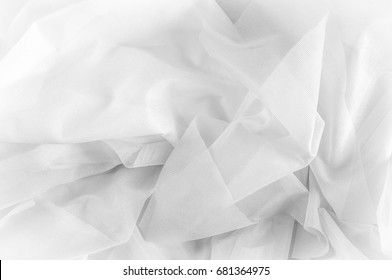 Texture, background, pattern. Texture of silk fabric - White. Silk fabric is transparent. Fabric or liquid wave illustration wavy creases of silk satin texture or velvet material or white