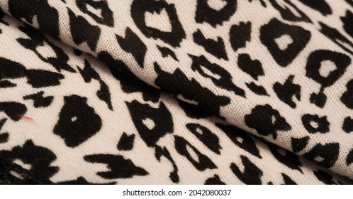 Texture, background, pattern, women's woolen shawl, black and beige, African motifs, shawl made of wool and modal with print in the form of a snake with a hem.