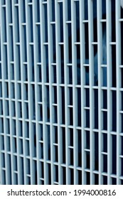 Texture background: protective gray metal iron grating, grid or stainless steel grate in perspective. Venting, ventilation