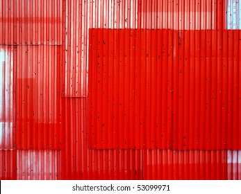 Texture background of red corrugated fence.