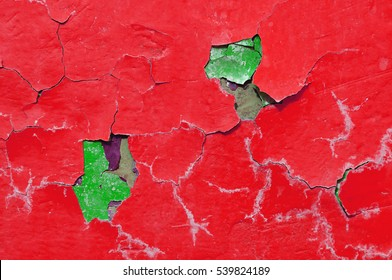 Texture background of red and green peeling paint on the old rough surface
