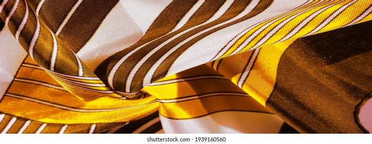 Texture, background, silk fabric with a yellow striped pattern. The design of this fabric is dedicated to a white rabbit mosaic representing the look of a fabulous vest.