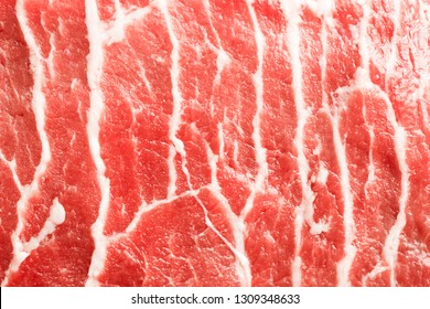 Texture or background of tasty fresh meat. Red beef meat close up texture. Meat food background.