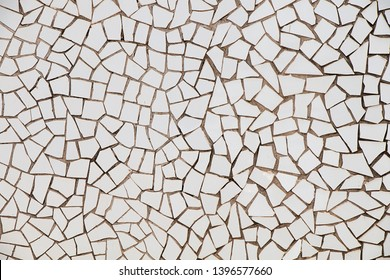 Texture, background. Wall of white tile fragments