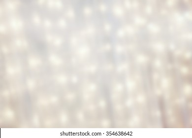 A texture or background with white linen and christmas lights blurred for use as an asset.