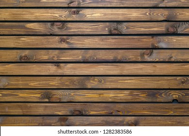 texture, background of wooden, varnished brown boards with bitches, arranged horizontally