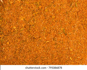 Texture background. Yellow spice mix for chicken  . Spices consist paprika onion garlic mustard coriander thyme celery turmeric fennel black pepper