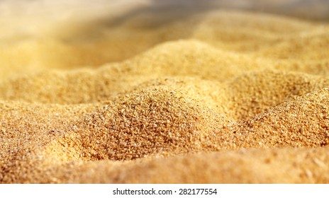 Texture of beach sand is photographed close-up