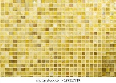 Texture: Beautiful yellow modern mosaic tile on wall.