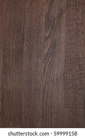 Texture of beech wood toned by dark walnut wood stain