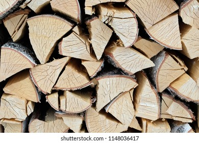 texture of birch chopped firewood, a large amount of firewood for the oven in the winter time