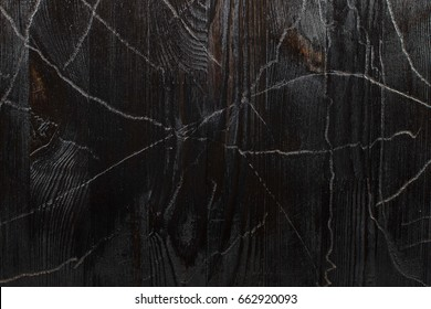 Texture black burnt wood with faux fading and cracking