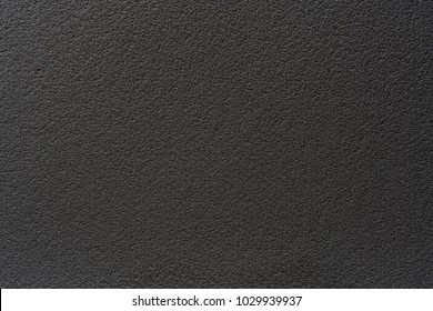 The texture of a black chalkboard. The background of black cloth. space for text.
