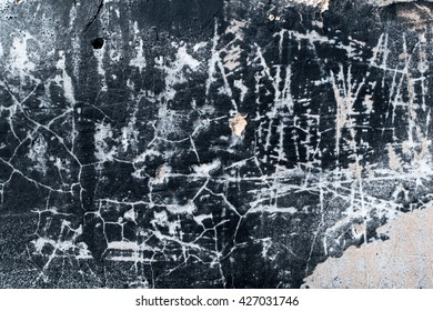 The Texture of a Black Cracked Wall