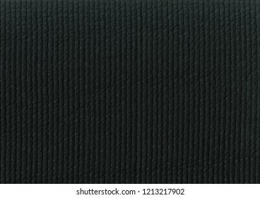 The texture of the black fabric for the background.