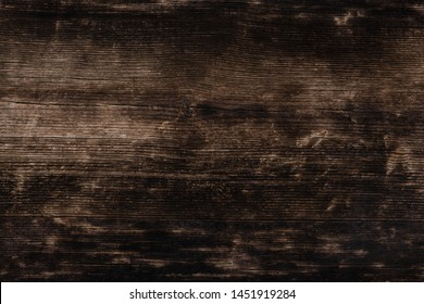 Texture Of A Black Gray Old Wooden Wall, Charred Horizontal Old Rambling Boards With Cracks. Burned Boards Textures Closeup.