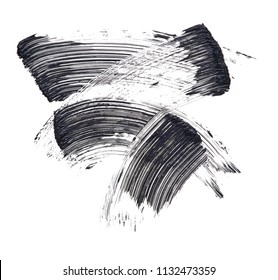 Texture of black mascara for eyelashes isolated on white background. Smear of black mascara for eyelashes on white background. Black mascara smears on white background