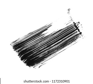 Texture of black mascara for eyelashes isolated on white background. Smear of black mascara for eyelashes on white background.
