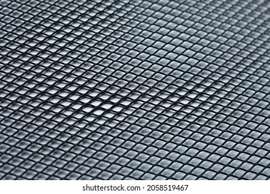 Texture: black metal iron grating, grid or stainless steel grate on white background. Venting, ventilation with geometric design pattern
