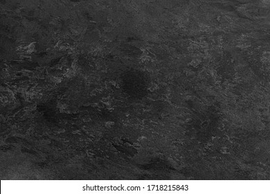 Texture of black monochrome decorative plaster or stucco. Abstract background for design.