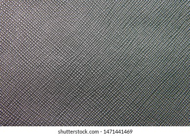 Texture of black natural leather with lines and bumps. Backdrop or background.