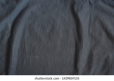 Texture black pressed cotton and polyester close-up