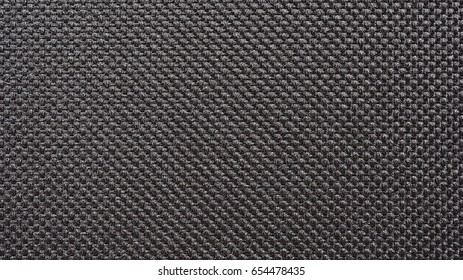 Texture of black synthetic fabric, Dark color tone of cloth pattern, Wallpaper background