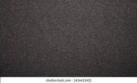 Texture black tight weave carpet.The dark background of the carpet.