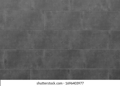 The texture of the black tile wall. Background of black tiled wall. Rectangular tile.