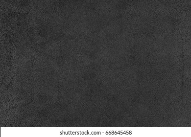 The texture of the black velvet. The background of black cloth. Background of black velvet