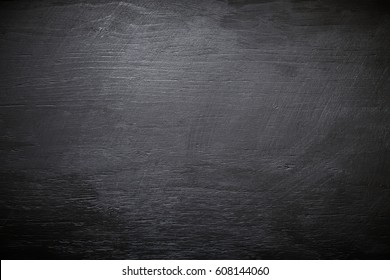 The texture of black wood. Dark texture. Flat lay.
