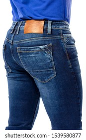 texture, blue men's jeans, men's ass covered with jeans close-up, back pocket jeans