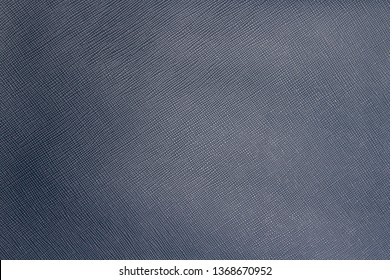 Texture of blue natural leather with lines and bumps. Backdrop or background.