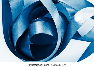 Texture of blue satin ribbon. Color of the year 2020 concept.