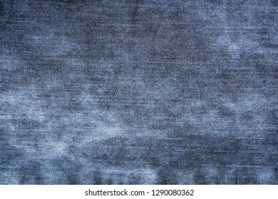 Texture of blue shabby jeans background