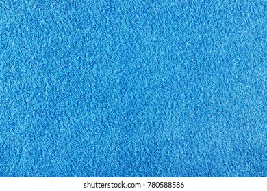 Texture of blue terry cloth closeup. Natural fabric background