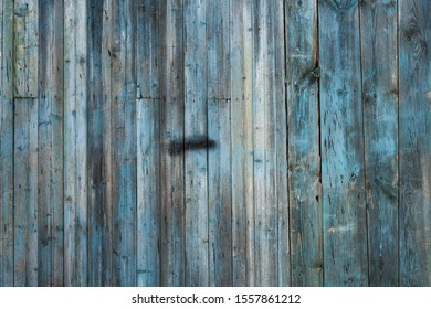 The texture of a blue wooden wall, background.