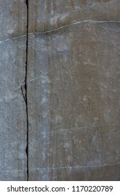 Texture of a bluish gray stone with cracks and crevices.