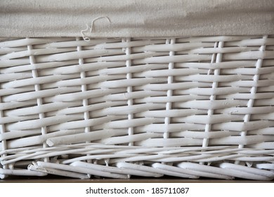 Texture from a box with natural wicker painted in white and textile white piece