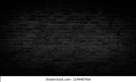 The texture of the brick is black. Background of empty brick basement wall.