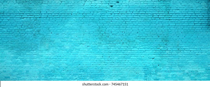 The texture of the brick wall of many rows of bricks painted in cyan color