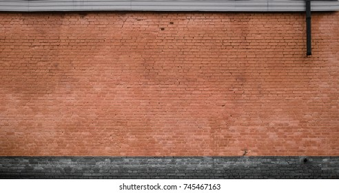The texture of the brick wall of many rows of bricks painted in brown color