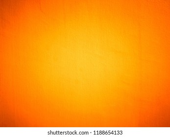 Texture of bright colorful orange paint retro style wall.
