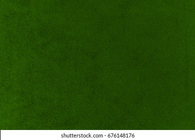 The texture of the bright green velvet. The background of bright green cloth. Background of     bright green velvet