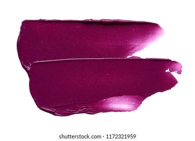 Texture of broken burgundy lipstick isolated on white background. Smear of burgundy lip gloss or creamy eye shadow isolated on a white background