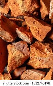 Texture of broken clay brick close up. Top view.